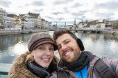 stock photo of zurich  - Beautiful Couple taking a selfie photo in Zurich - JPG