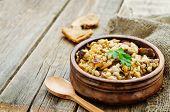stock photo of porridge  - barley porridge with mushrooms on a dark wood background - JPG