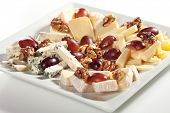 pic of cheese platter  - Assorted Cheeses with Grapes and Nuts on Platter - JPG