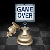 stock photo of terminator  - Game over business concept as an open king chess piece on a checkered board with a sign emerging with words representing the competitive metaphor and symbol for the end or termination as a winner or loser - JPG