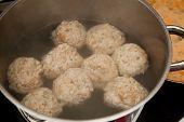 stock photo of boil  - Dumplings in a boiling pot - JPG