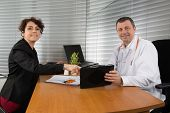 picture of rep  - Woman Pharmaceutical Sales Representative with the doctor - JPG