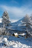foto of west village  - Fresh snow covering hills trees and houses in the Peak district North West England - JPG