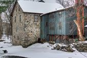 picture of water-mill  - Old mill along a river after a heavy snow fall - JPG