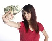 foto of twenty dollar bill  - Close up Smiling Young Woman in Casual Red Shirt Showing a Fan of 20 US Dollar Bills While Looking at the Camera - JPG