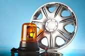 pic of alloy  - shiny alloy wheel with road emergency items - JPG
