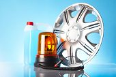 foto of alloy  - shiny alloy wheel with road emergency items - JPG