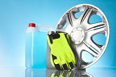 image of alloy  - alloy wheel and car accessories on blue background - JPG