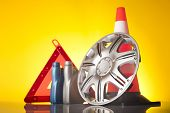 stock photo of rectifier  - warning triangle and car service accessories on yellow background - JPG
