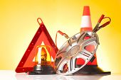 image of rectifier  - road emergency items and car accessories on yellow background - JPG