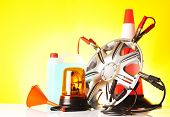 pic of rectifier  - road emergency items and car accessories on yellow background - JPG