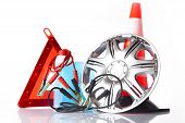 picture of alloy  - car accessories with alloy wheel and traffic cone - JPG
