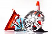 stock photo of alloy  - car accessories with alloy wheel and traffic cone - JPG