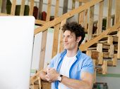 picture of draft  - Man working with drafts in office - JPG