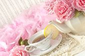 picture of mother-of-pearl  - A Mothers Day tea party still life with fresh hot tea with lemon and fresh pink roses plenty of space for text - JPG