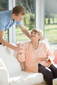picture of caring  - Male care assistant caring about elder woman - JPG