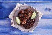 image of jerks  - grilled jamaican jerk chicken with black beans shot top down - JPG