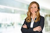 stock photo of employee  - Young woman giving help as a customer service employee - JPG