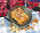 pic of halwa  - Almond Halwa in antique plate with various natural dry fruits - JPG