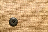 stock photo of hasp  - One big old button on old cloth - JPG