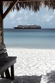 foto of cruise ship caribbean  - Caribbean sand beach with cruise ship at the background in Half Moon Cay - JPG