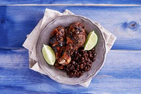 picture of jerks  - grilled jamaican jerk chicken with black beans shot top down - JPG