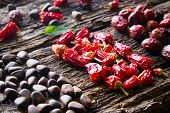 pic of pine nut  - leaf pine nuts dried red peppers and wild rose on wooden background close - JPG