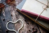 stock photo of pine nut  - glasses tied with a rope in a book with heart - JPG