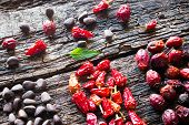 stock photo of pine nut  - leaf pine nuts dried red peppers and wild rose on a wooden background selective focus - JPG
