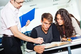 stock photo of professor  - Students in classroom getting lecture from professor - JPG