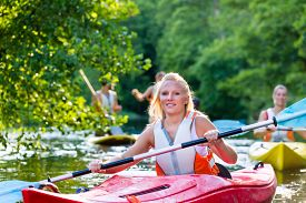 picture of kayak  - woman with kayak or canoe on forest river - JPG