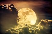 Постер, плакат: Nighttime Sky With Clouds And Bright Full Moon With Shiny Sepia Tone