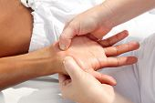 stock photo of reflexology  - digital pressure hands reflexology massage tuina therapy physiotherapy - JPG