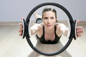 foto of saxy  - magic pilates ring woman aerobics sport gym exercises on wooden floor - JPG