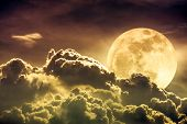 Nighttime Sky With Clouds And Bright Full Moon With Shiny.  Sepia Tone. poster