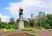 George Washington statue as the famous landmark in Boston Common Park with city skyline and skyscrapers. poster