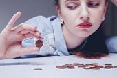 Family Debts. Young Frustrated And Desperate Woman Counting Small Money As Symbol Of Bankrupt And Po poster