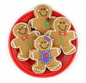 picture of gingerbread man  - Gingerbread cookies on a red plate isolated on white - JPG