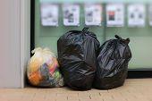 Three Trash Bags, Garbage Bag Black Placed Front Convenience Store, Bin, Trash, Trash Bag, Trash On  poster