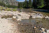 Natural Geothermal Hot Spring In Idaho - Sacajawea Hot Springs In Grandjean. Large Stones Arranged I poster