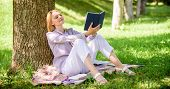 Self Improvement And Education Concept. Business Lady Find Minute To Read Book Improve Her Knowledge poster