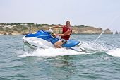 foto of jet-ski  - Young guy cruising on the atlantic ocean on a jet ski - JPG