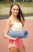 Fitness Girl With Yoga Mat Standing Outdoor In Nature - Fit Woman With Exercise Accessory At Stadium poster