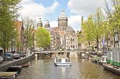 Cruising through Amsterdam canals in the Netherlands with the St. Nicolas Church