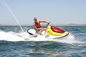 image of ski boat  - Young guy cruising on the atlantic ocean on a jet ski - JPG