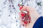 Valentine Day Nail Art Design Manicure. Female Hand With Bright Red Heart Manicure Holding Red Berri poster