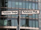 Big Road Signs With Street Name Of Potsdamer Strasse And Platz That Means Potsdam Street And Square  poster