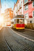 Touristic Vintage Red Tram In A Lisbon Street On Sunny Afternoon, Narrow Streets, Cobblestones Windi poster