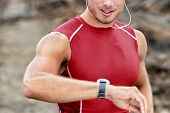 Smartwatch man athlete runner checking his wearable device tech smart watch during outdoor training  poster