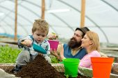 Rich Land. Land Rich With Fertile. Rich Land For Growing Plants. Family In Greenhouse Work With Rich poster